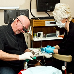 Dentist offering dental care