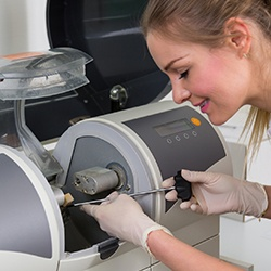 Dental assistant working with CEREC unit
