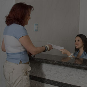 Female patient checking in at front desk