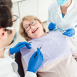 Patient smiling in dentist's treatment chair