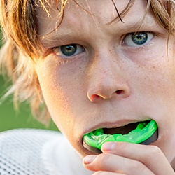 Young boy with green sportsguard