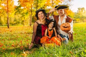 family of three dressed in costumes