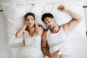 husband snoring and keeping wife awake