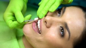 a woman undergoing cosmetic dentistry
