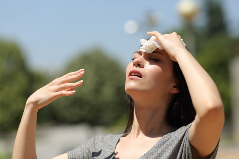 Woman experiencing signs of dehydration